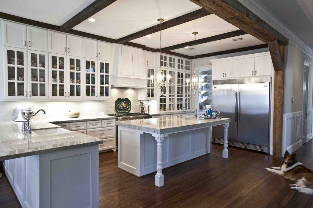 white kitchen with rustic beams